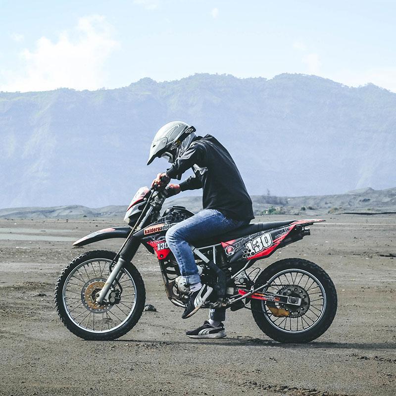 photo of a man riding a dirt bike